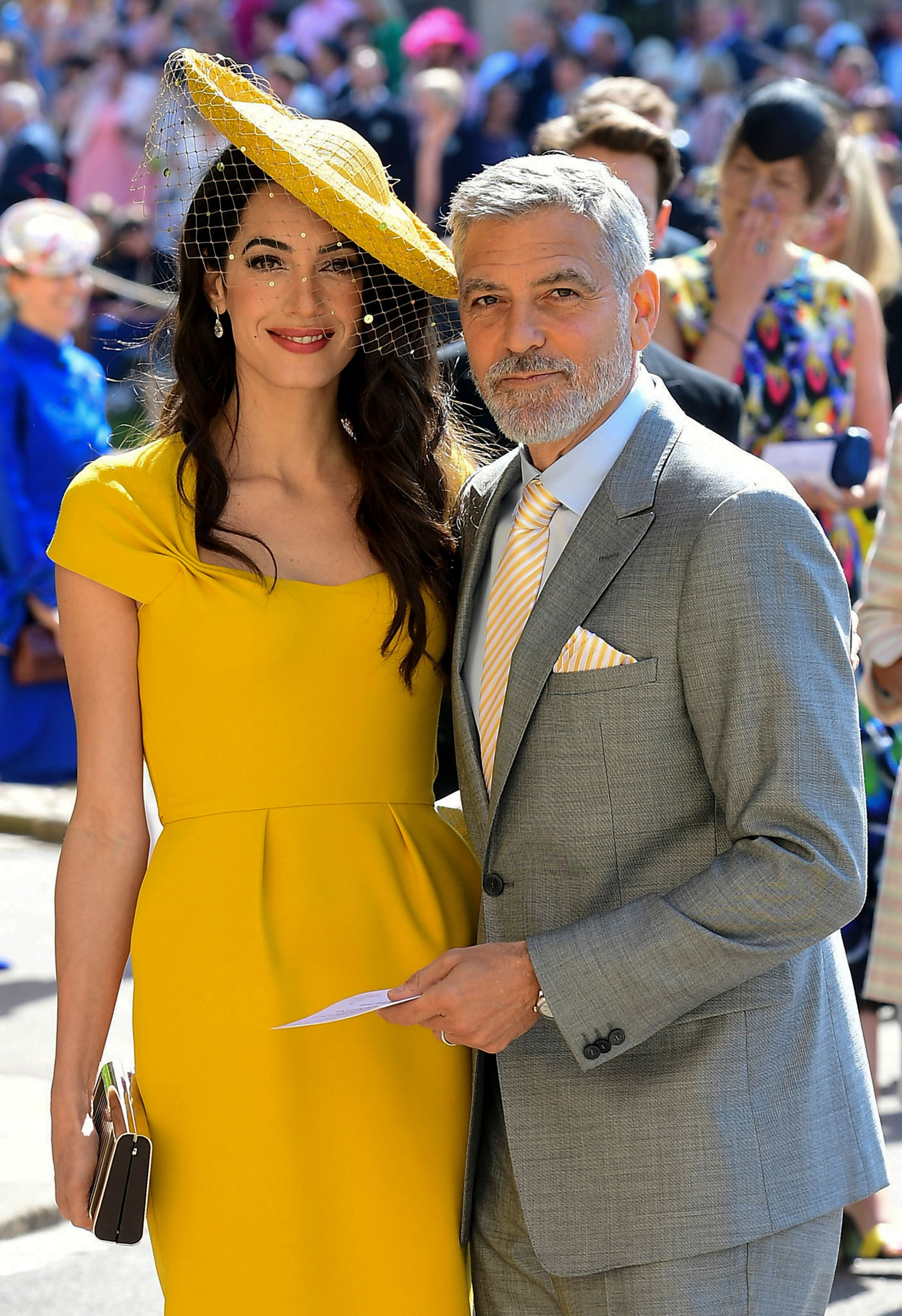 George Clooney and Amal Clooney arrive for the wedding ceremony of Britain's Prince Harry, Duke of Sussex and US actress Meghan Markle at St George's Chapel, Windsor Castle, in Windsor, on May 19, 2018. | Source: Getty Images