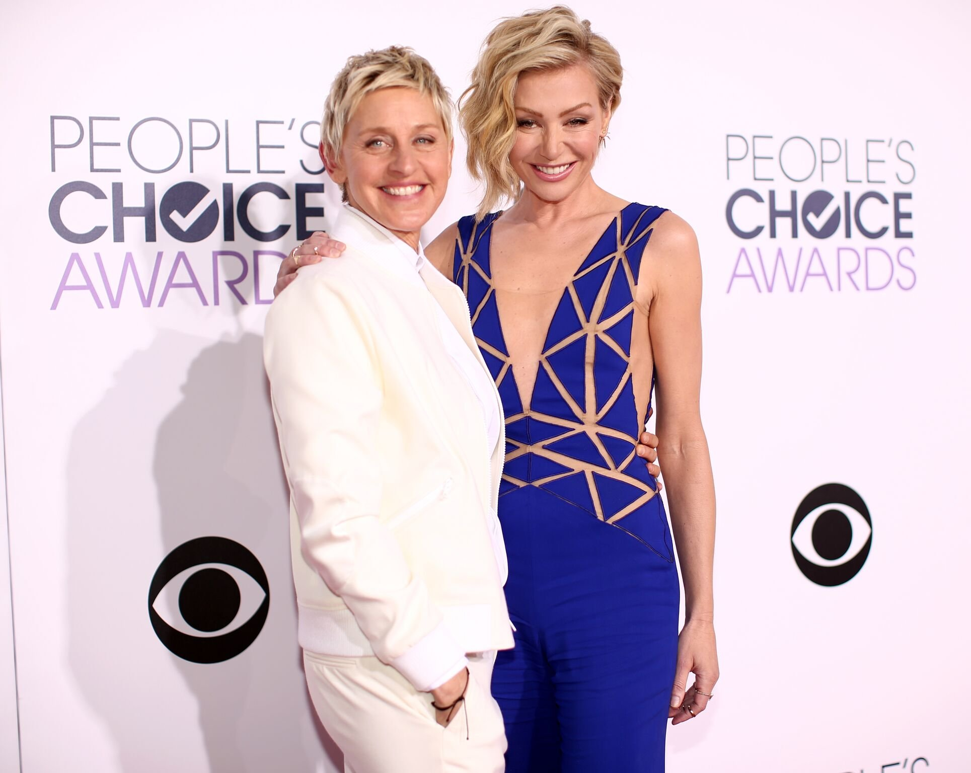 Ellen DeGeneres (L) and actress Portia de Rossi attend The 41st Annual People's Choice Awards at Nokia Theatre LA Live | Getty Images / Global Images Ukraine