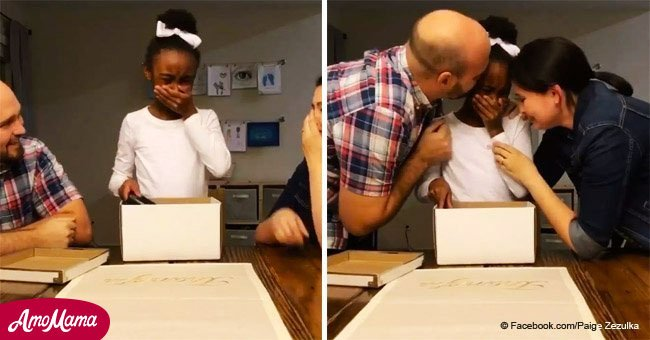 Bittersweet moment girl bursts into tears when she hears she's being adopted