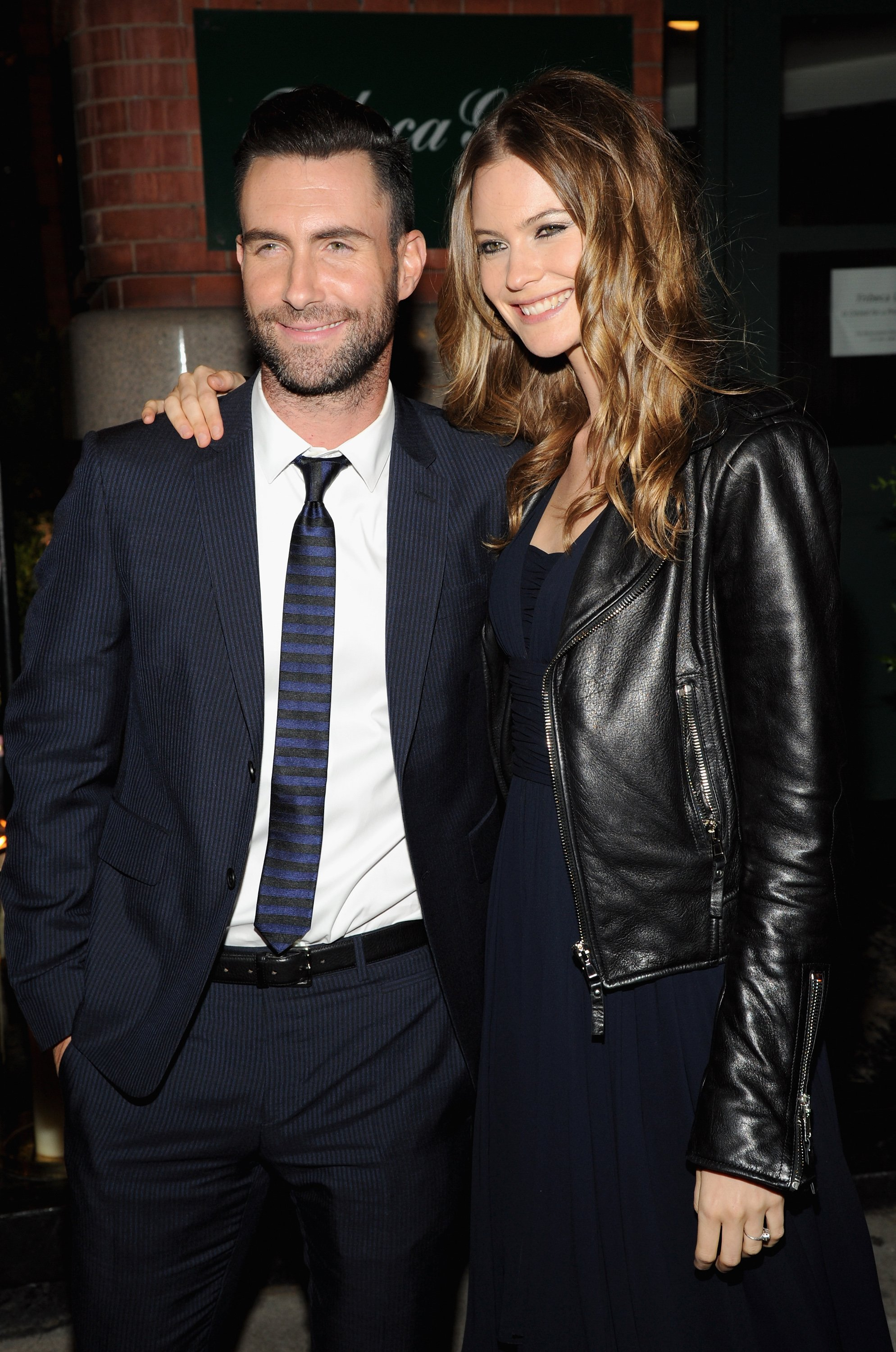 Adam Levine and Behati Prinsloo at the CHANEL Dinner in honor of the 2014 Tribeca Film Festival closing night film 'Begin Again' at Tribeca Grill on April 26, 2014 in New York City | Photo: Getty Images