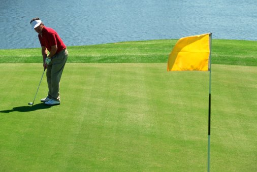 Photo of a man preparing to put on a golf course   Photo: Getty Images