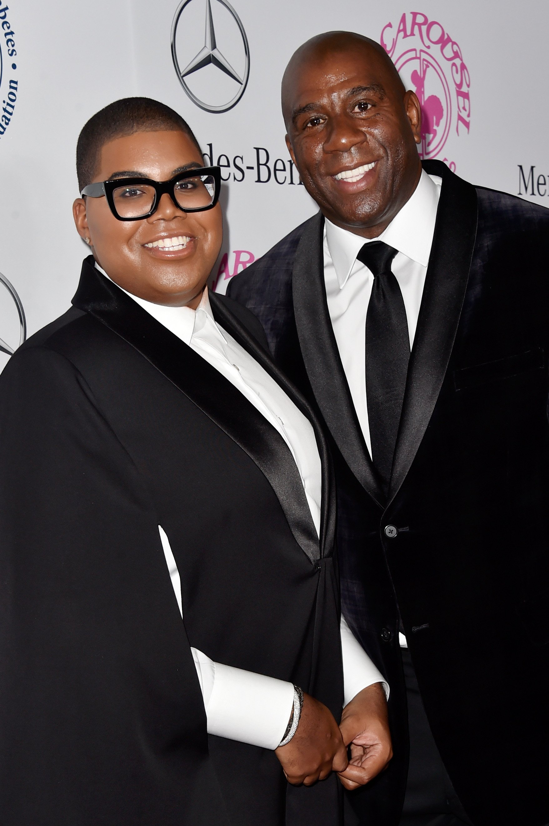 EJ Johnso and Magic Johnson at the 2014 Carousel of Hope Ball on October 11, 2014 in Beverly Hills, California | Photo: Getty Images