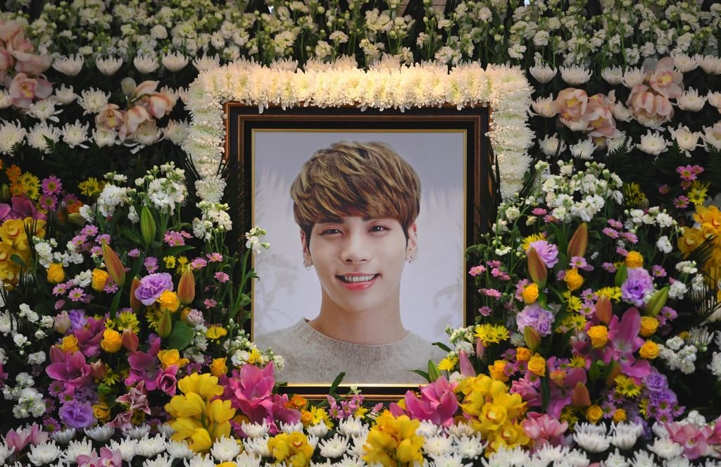 The portrait of Kim Jong-Hyun, a 27-year-old lead singer of the massively popular K-pop boyband SHINee, is seen on a mourning altar at a hospital in Seoul on December 19, 2017. | Source: Getty Images