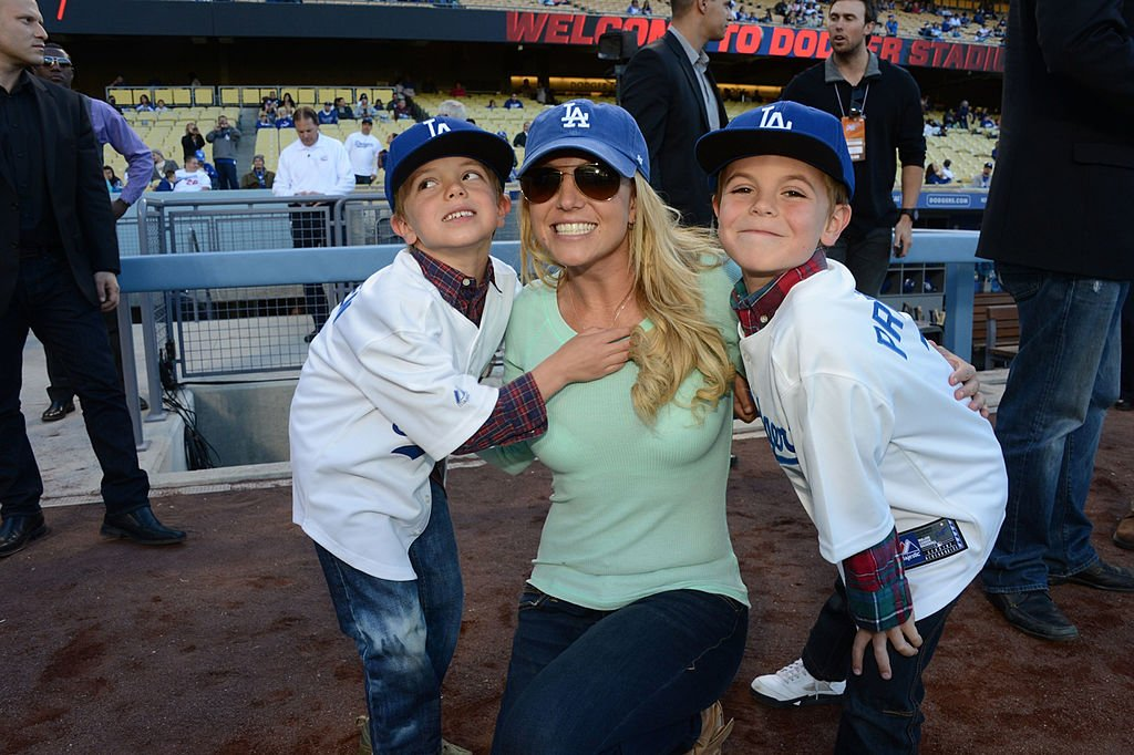 Britney Spears poses with sons Jayden James Federline (L) and Sean Preston Federline (R) during a game against the San Diego Padres at Dodger Stadium on April 17, 2013 in Los Angeles, California. | Source: Getty Images