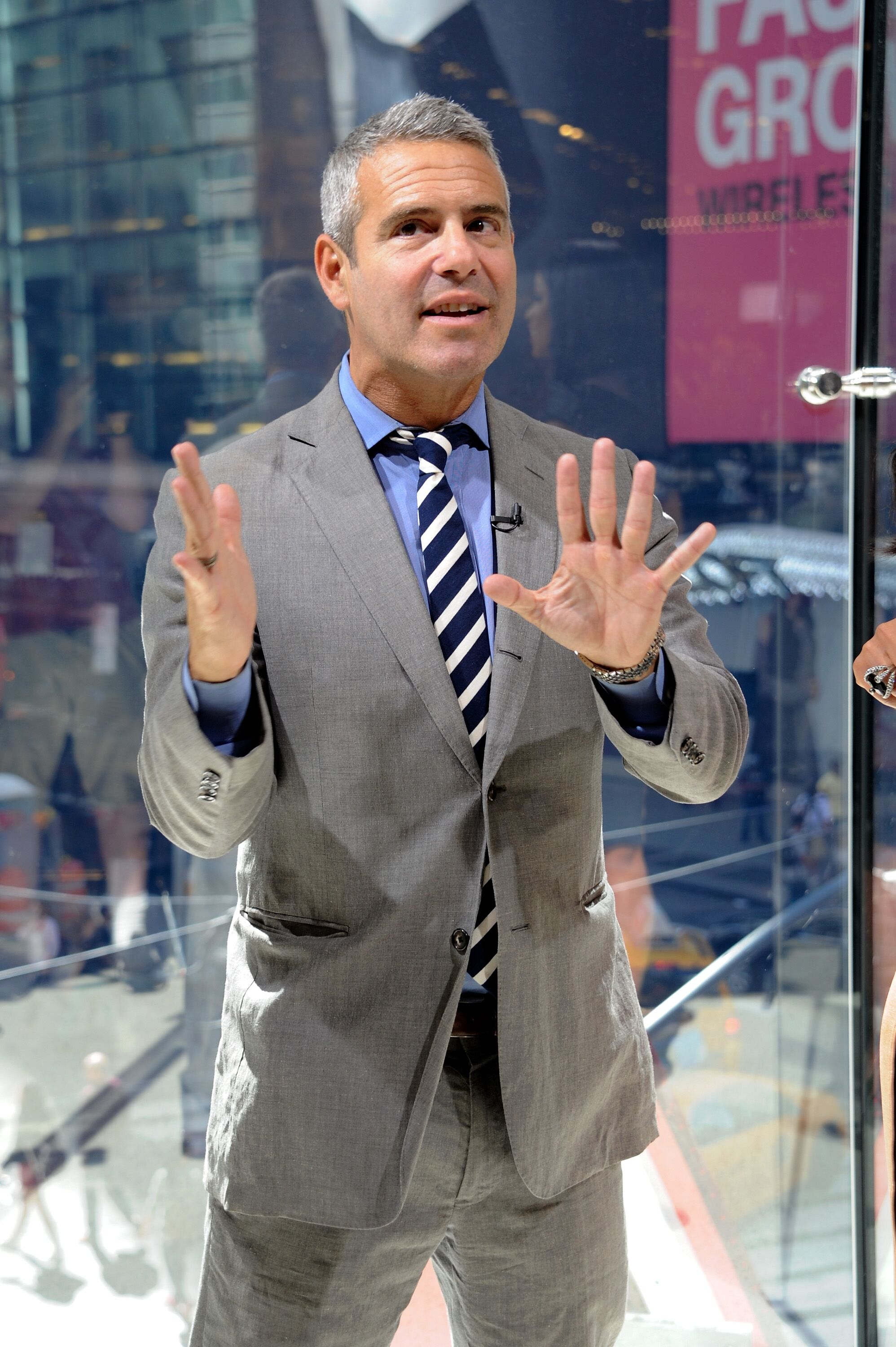 "Andy Cohen visits ""Extra"" at their New York studios at H&M in Times Square 