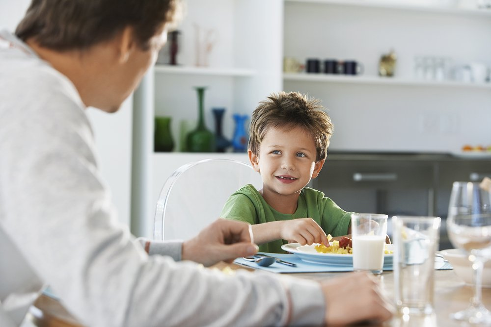Father and son at the breakfast table | Photo: Shutterstock/sirtravelalot