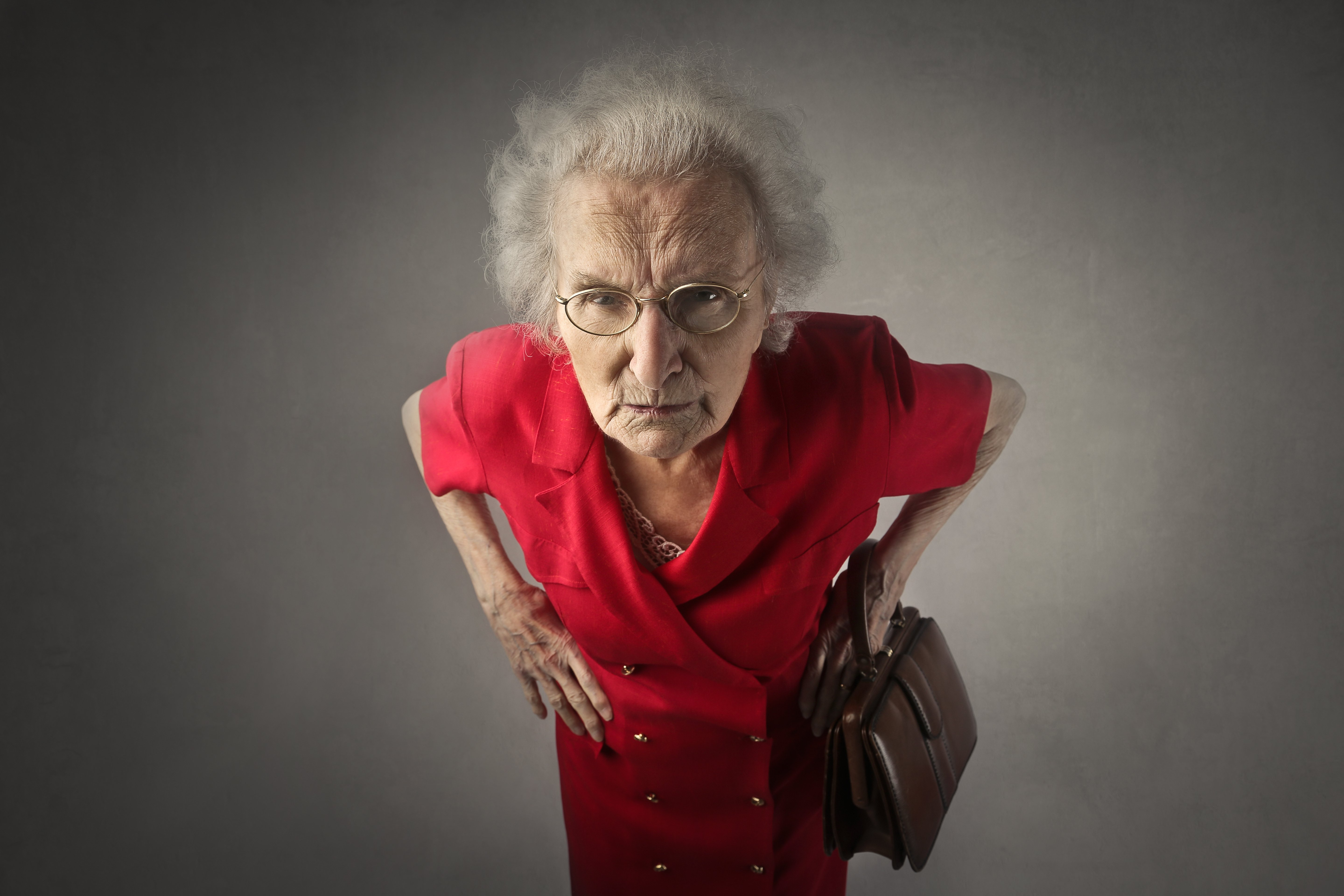 An angry lady dressed in red.   Source: Shutterstock.