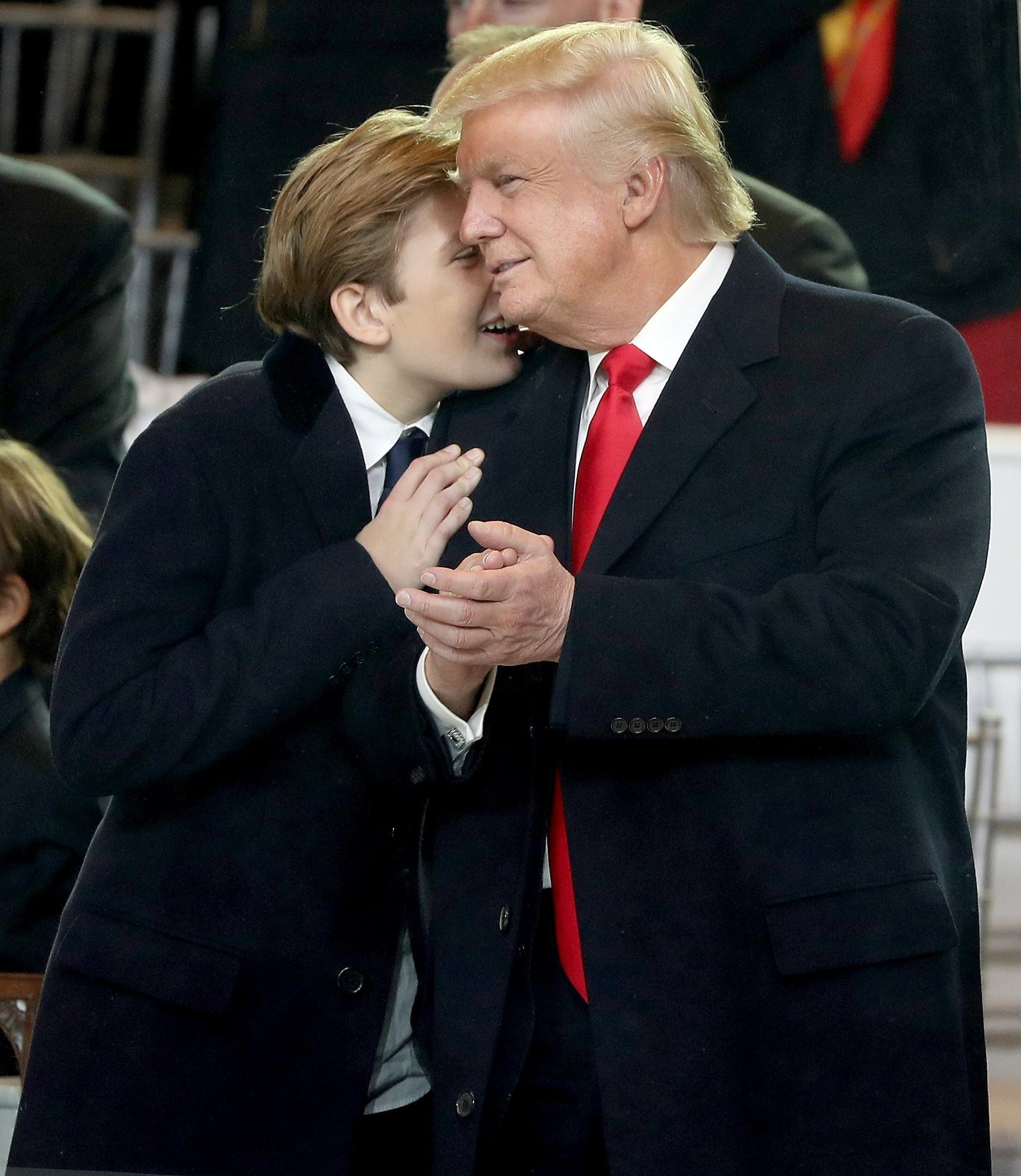 Barron Trump whispering to father President Donald Trump | Photo: Getty Images