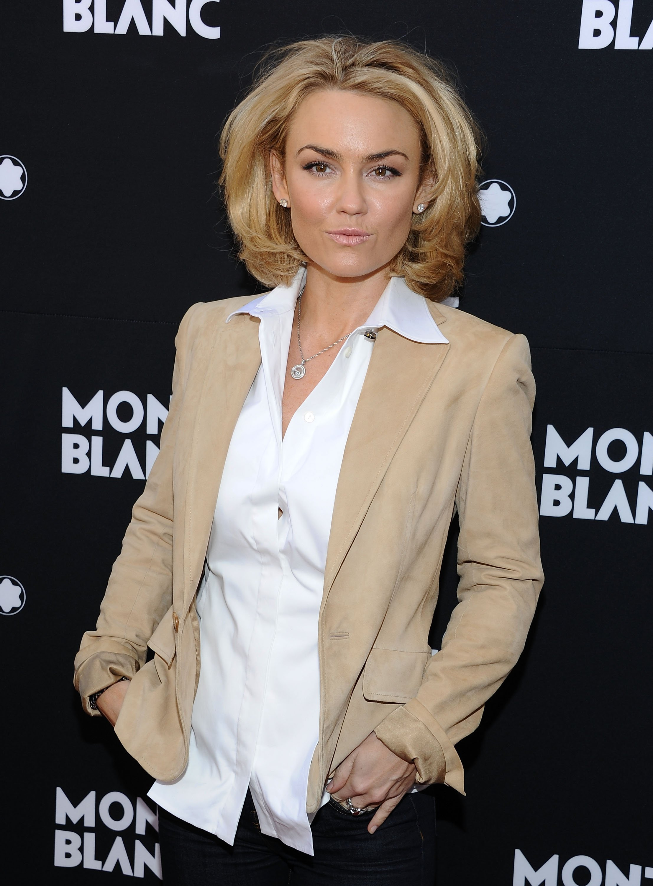 Kelly Carlson arrives at the Montblanc Pre-Oscar brunch celebrating Princesse Grace De Monaco Collection at Bel Air Hotel on February 25, 2012, in Los Angeles, California. | Source: Getty Images.