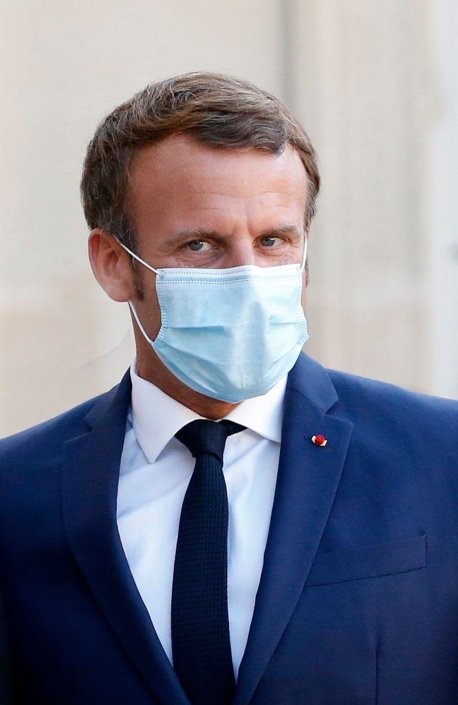 Emmanuel Macron portant un cache-nez / Source : Getty Images