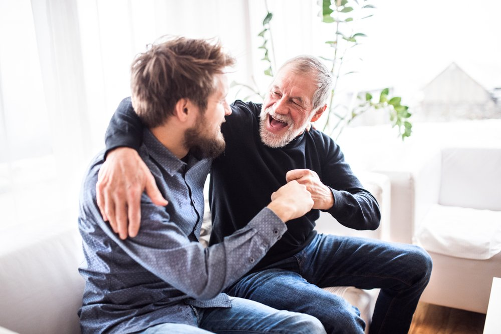 The old man laughing with the boy | Shutterstock