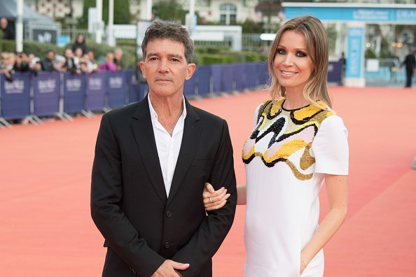 Antonio Banderas and Nicole Kimpel standing on the red carpet of the 43rd Deauville American Film Festival on September 6, 2017. | Source: Getty images