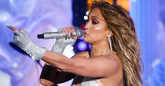J-Lo, 51, Puts on Very Leggy Display Wearing Only a White Bathrobe in Bed
