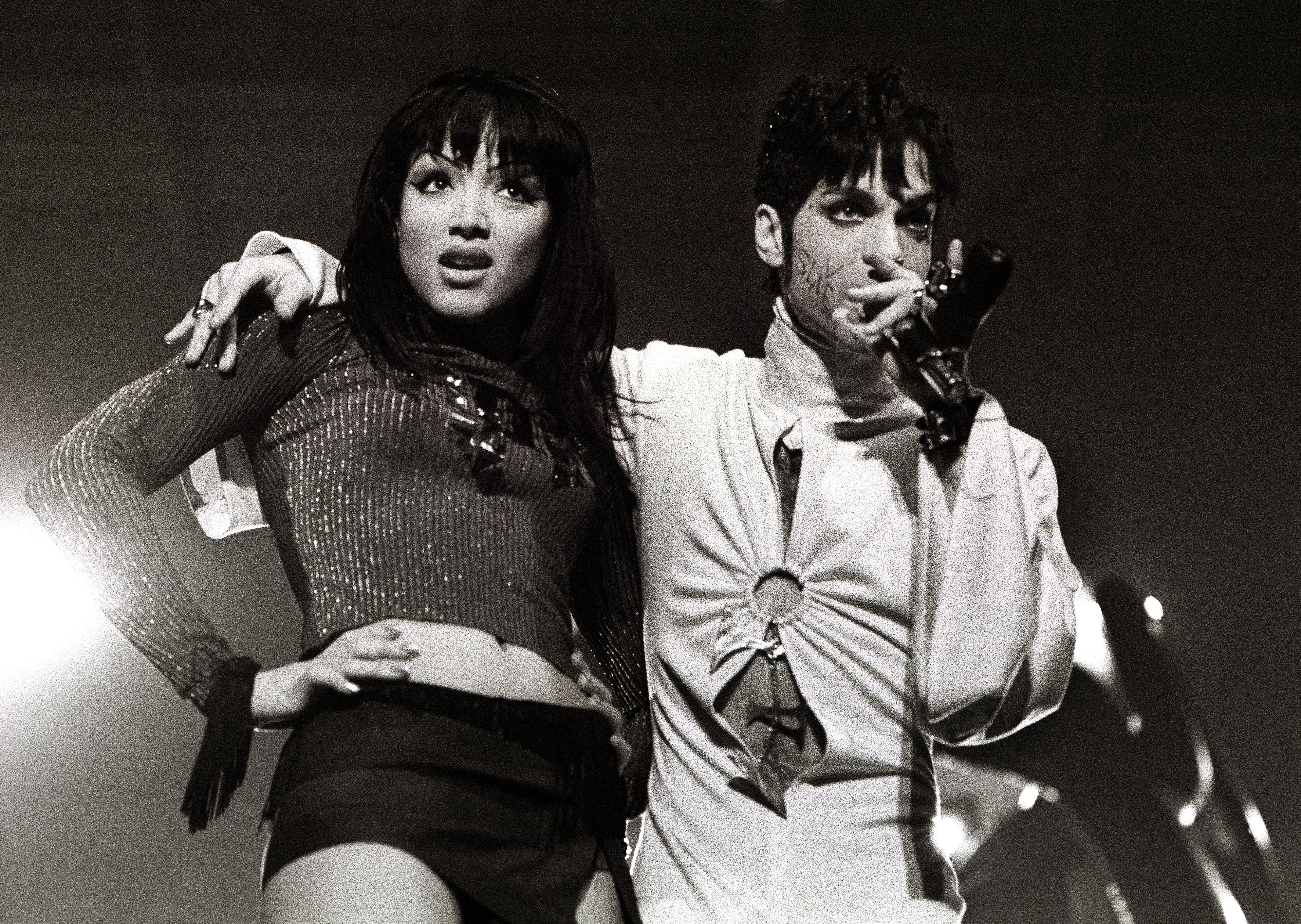 Prince and Mayte Garcia perform on stage at Brabant hallen, Den Bosch, Netherlands, 24th March 1995 | Photo: Getty Images