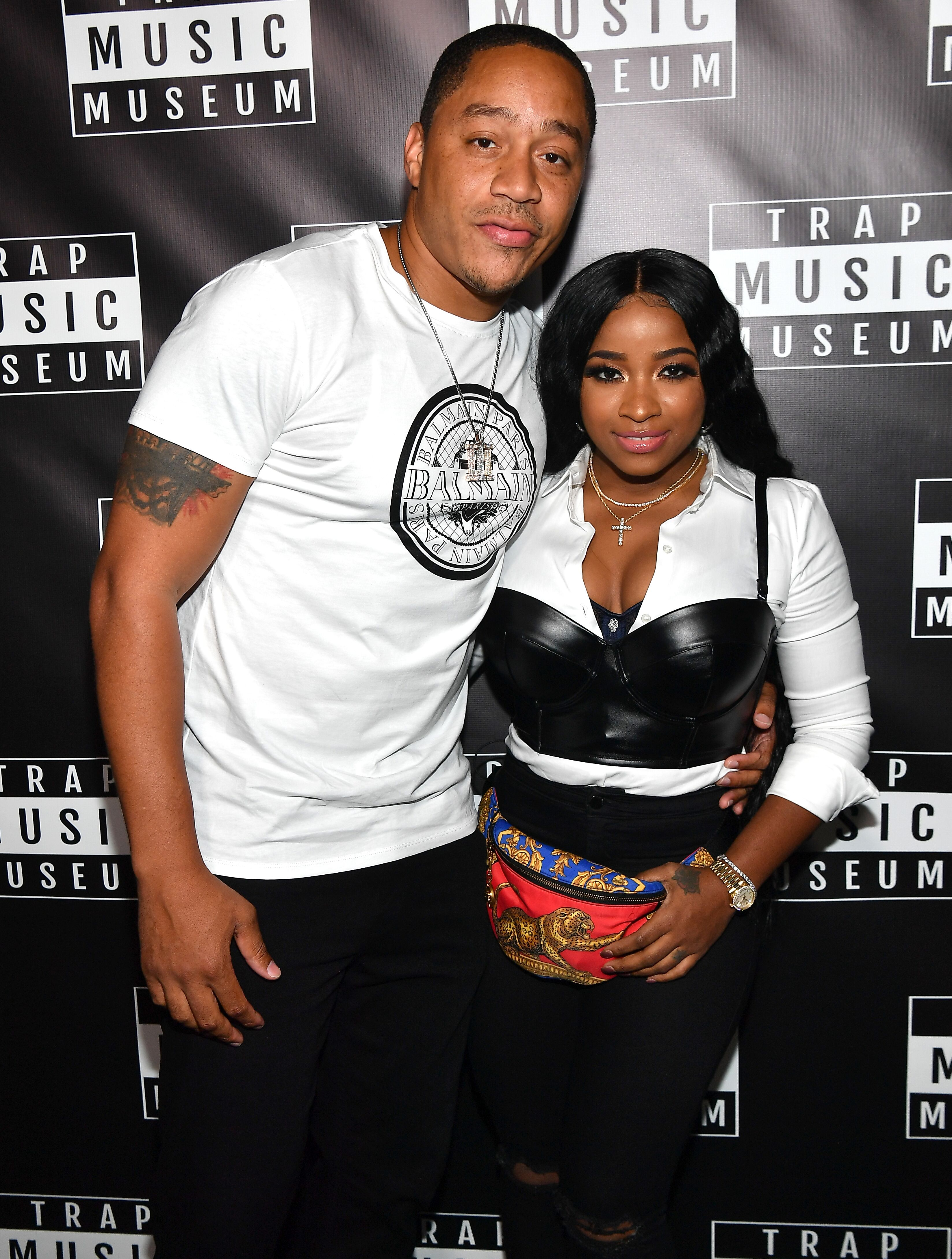 Toya Johnson and her fiancé, Robert Rushing pose at the VIP preview of Trap Music Museum in September 2018. | Photo: Getty Images