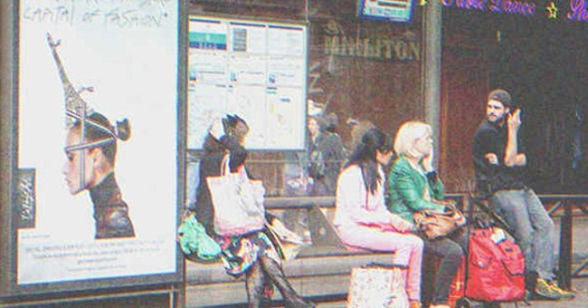 Several people at a bus stop. | Source: Shutterstock