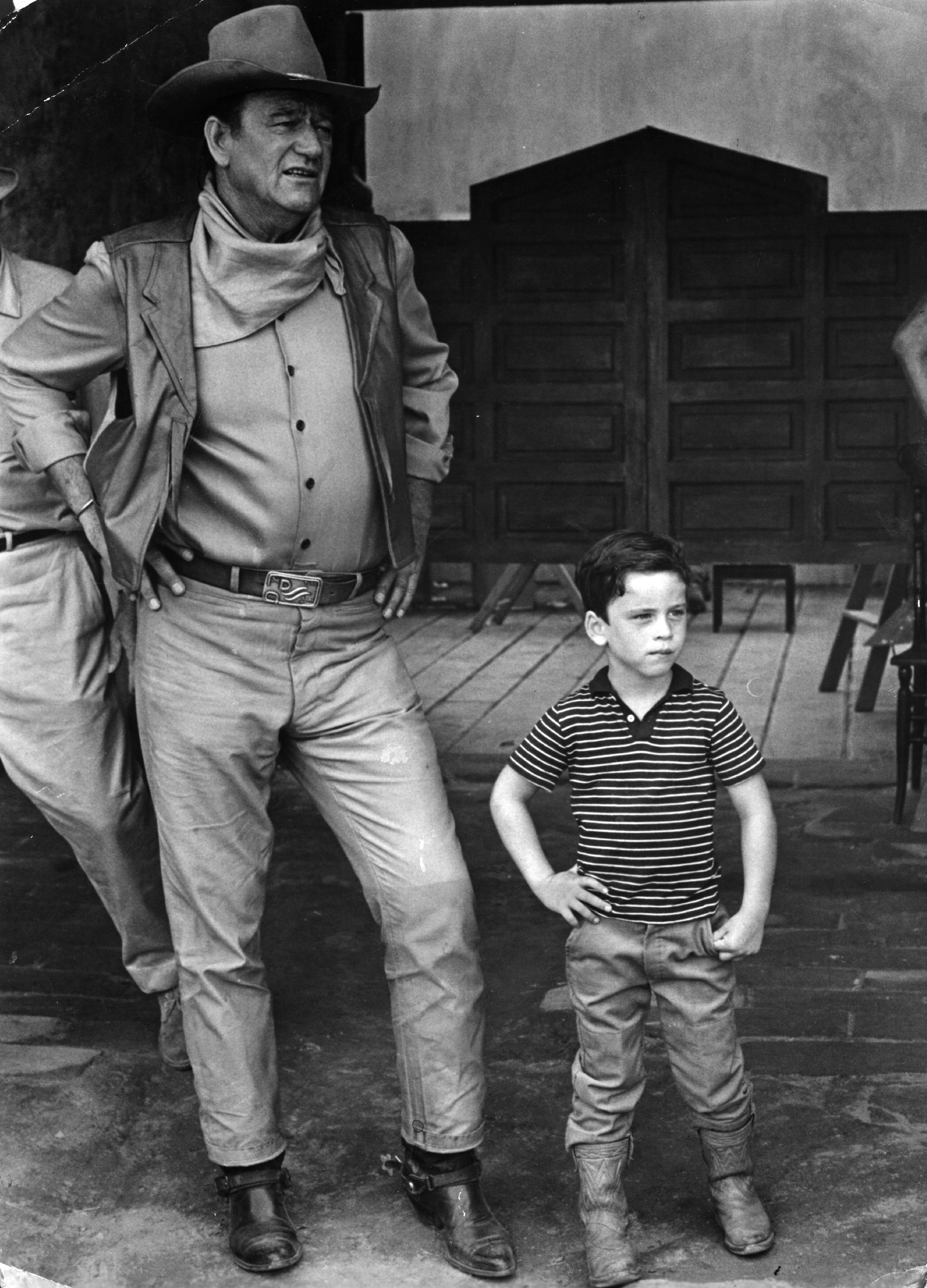 """John Wayne and his son on location in Mexico for the filming of """"War Wagon."""" 