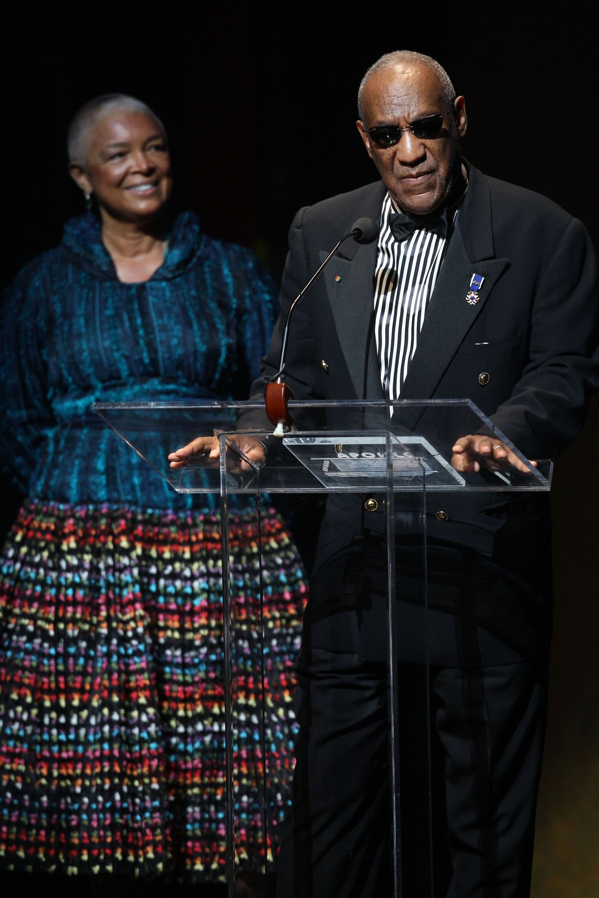 Bill Cosby giving a speech as wife Camille looks on | Source: Getty Images