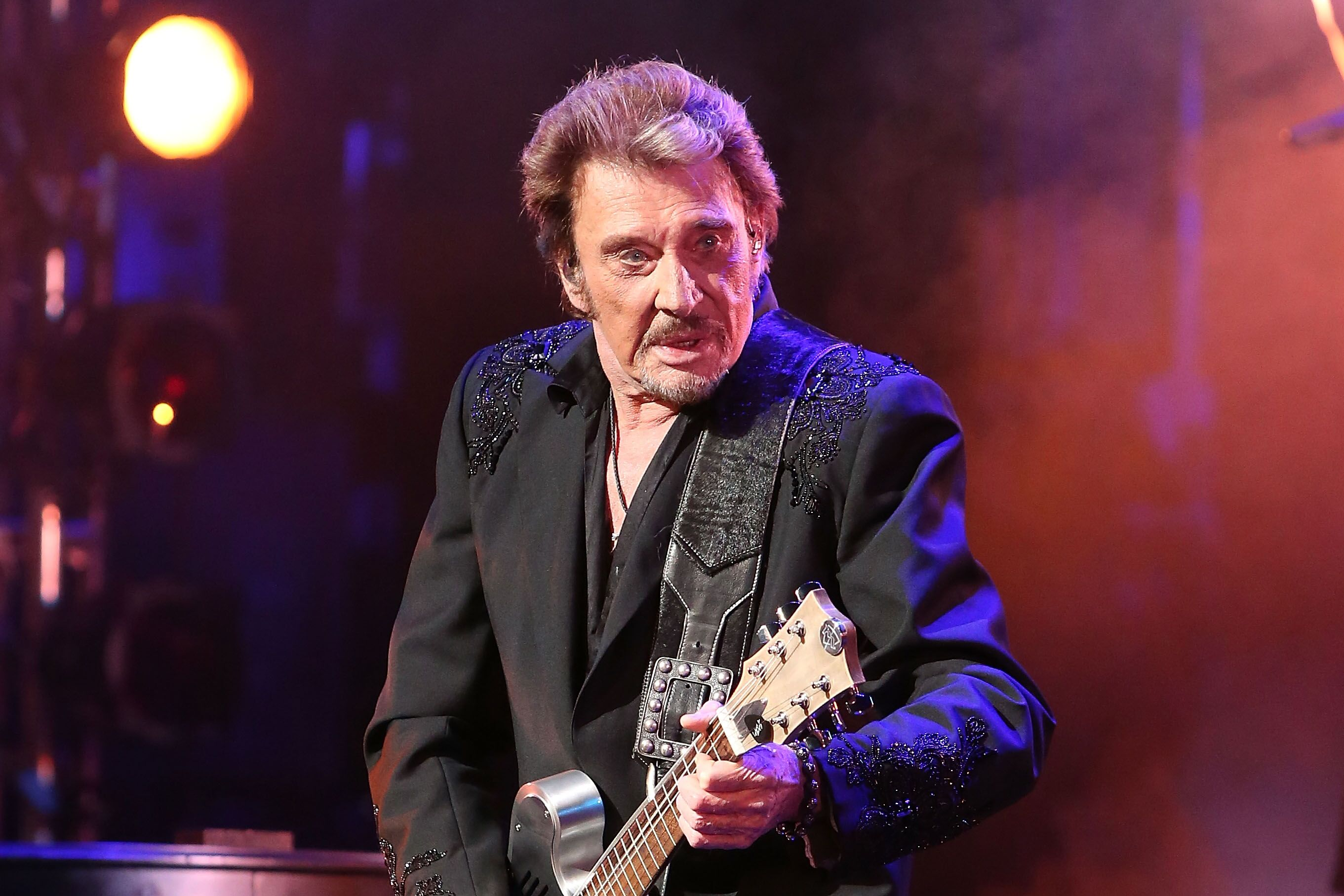 Johnny Hallyday chante sur scène au Beacon Theatre le 6 mai 2014 à New York. | Photo : Getty Images