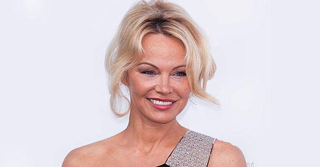 Pamela Anderson Shows off Her World-Famous Curves in a Black Swimsuit and Heels