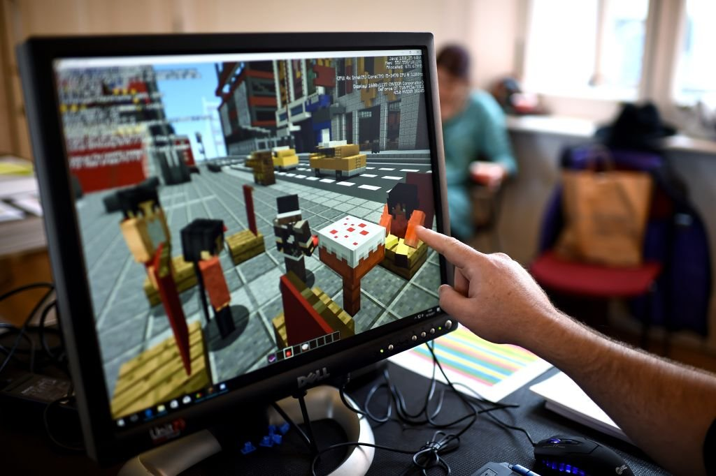 A Minecraft digital artist points at the digital version of the character 'Sal' as they work backstage during a 'Playcraft' live rehearsal.   Source: Getty Images