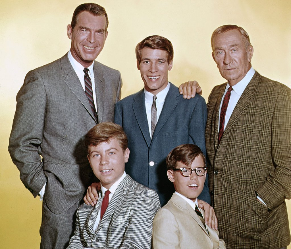 "Stanley Livingston and casts of ""My Three Sons"" posing on the set of the show 