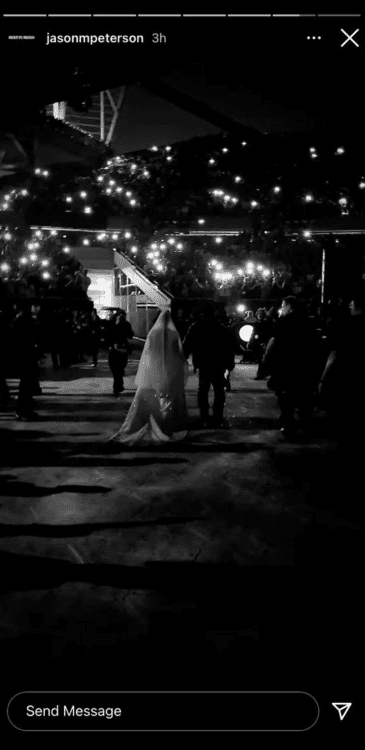 A screenshot of Kim Kardashian showing up in a wedding dress at Kanye West's concert | Photo: Instagramjasonmpeterson