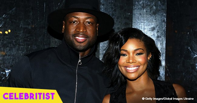 Gabrielle Union stuns in a neon cut-out swimsuit while on vacation with husband Dwyane Wade