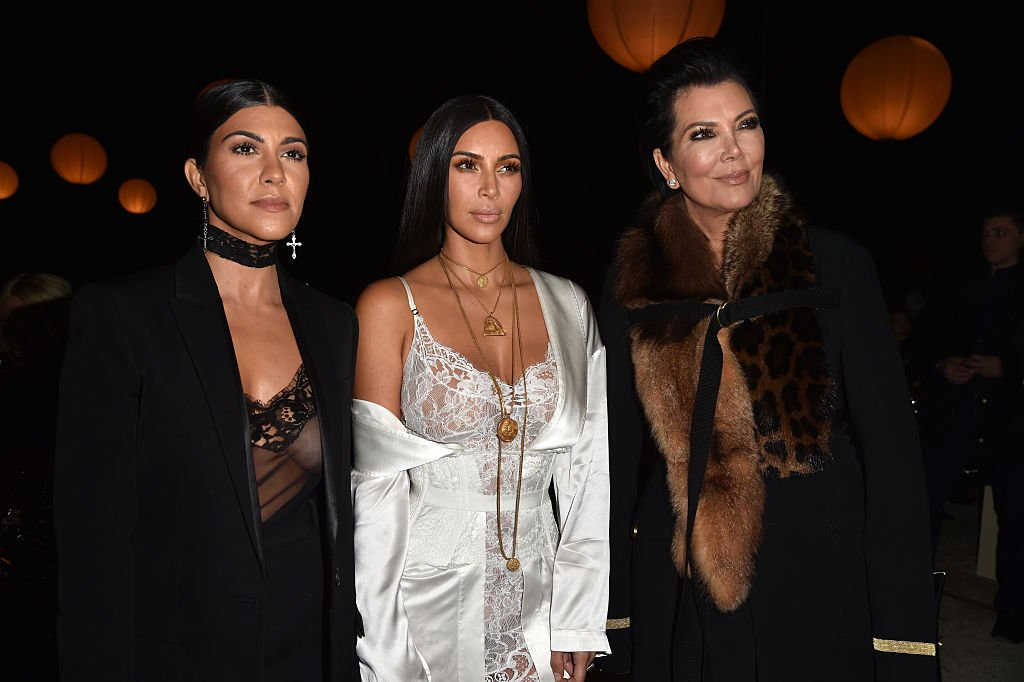 Kris Jenner with her daughters, Kourtney and Kim Kardashian at the Givenchy show in Paris in October 2016. | Photo: Getty Images