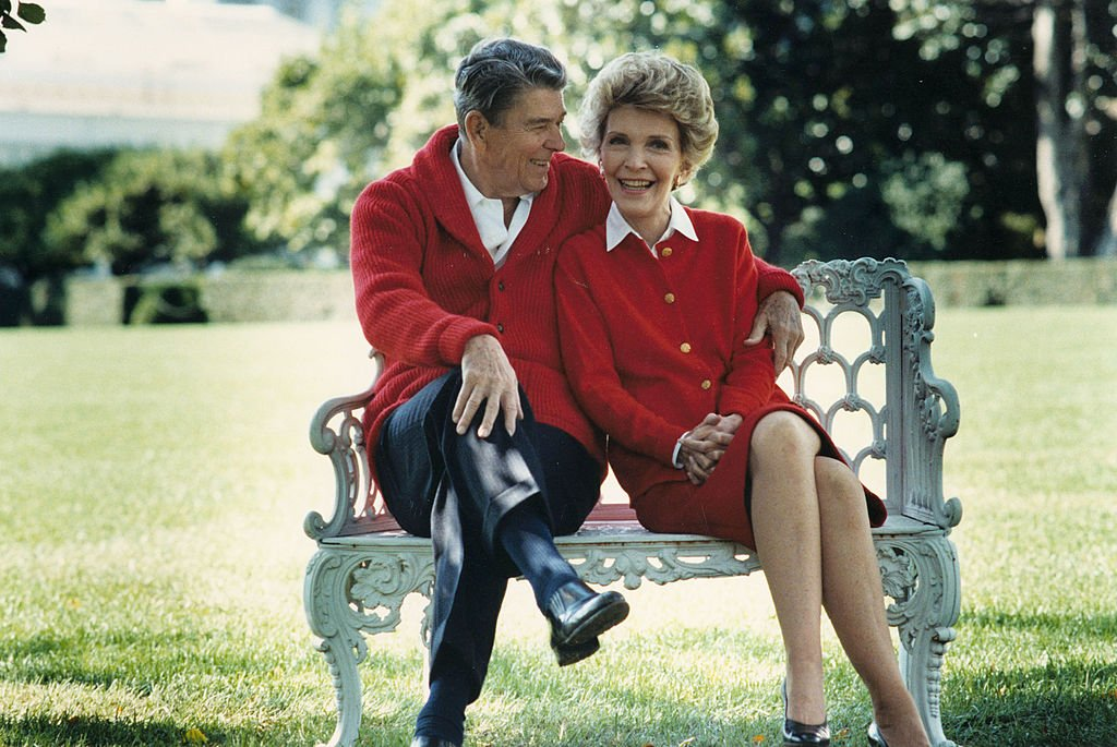 Former U.S. President Ronald Reagan and First Lady Nancy Reagan share a moment in this undated file photo. Reagan turns 93 on February 6, 2004. | Source: Getty Images