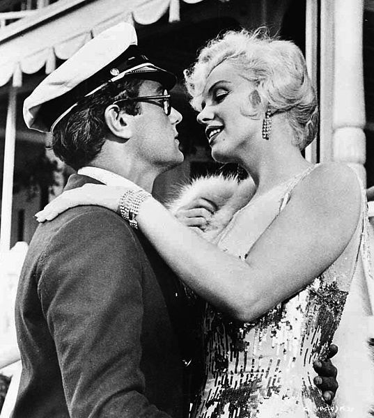 """Marilyn Monroe and Tony Curtis in a promotional image for the 1959 film """"Some Like it Hot"""" 