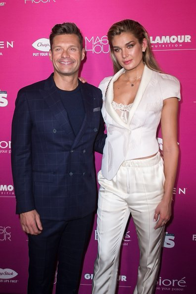 Ryan Seacrest and Shayna Taylor  at Magic Hour Rooftop Bar & Lounge on September 12, 2018 in New York City | Photo: Getty Images