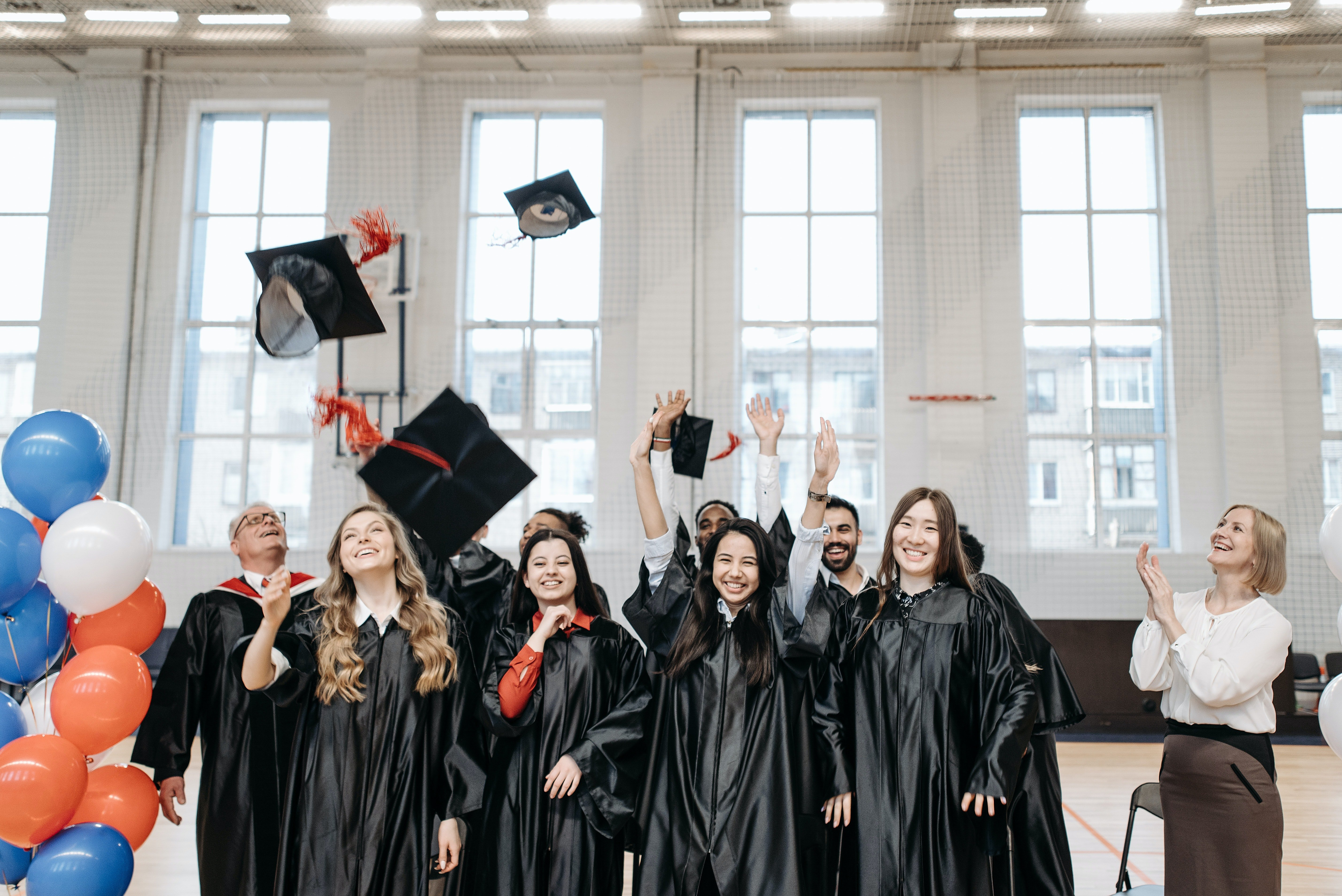 Students after receiving their high school diplomas | Source: Pexels