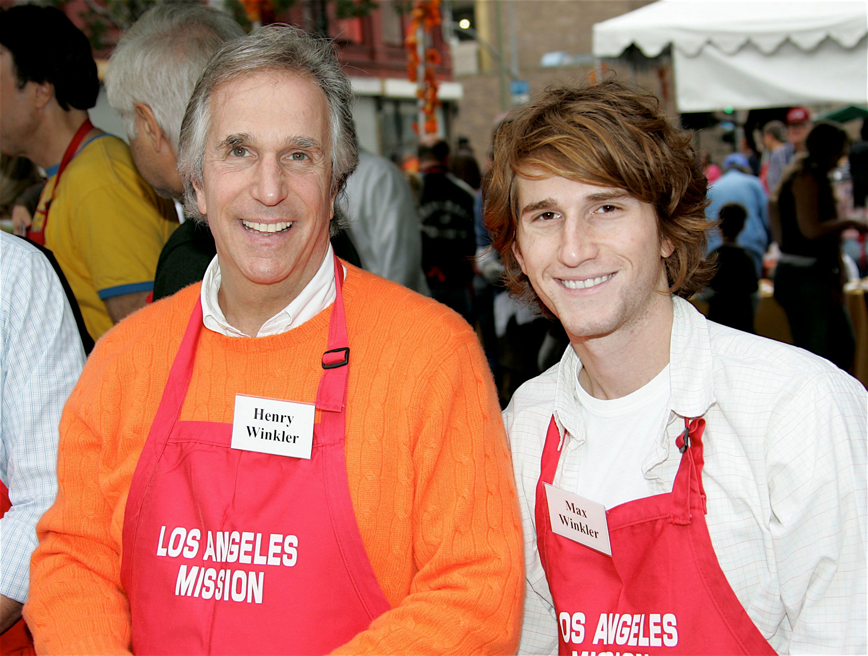 Henry Winkler and Max Winkler pose at the Los Angeles Mission Thanksgiving. | Source:Getty Images
