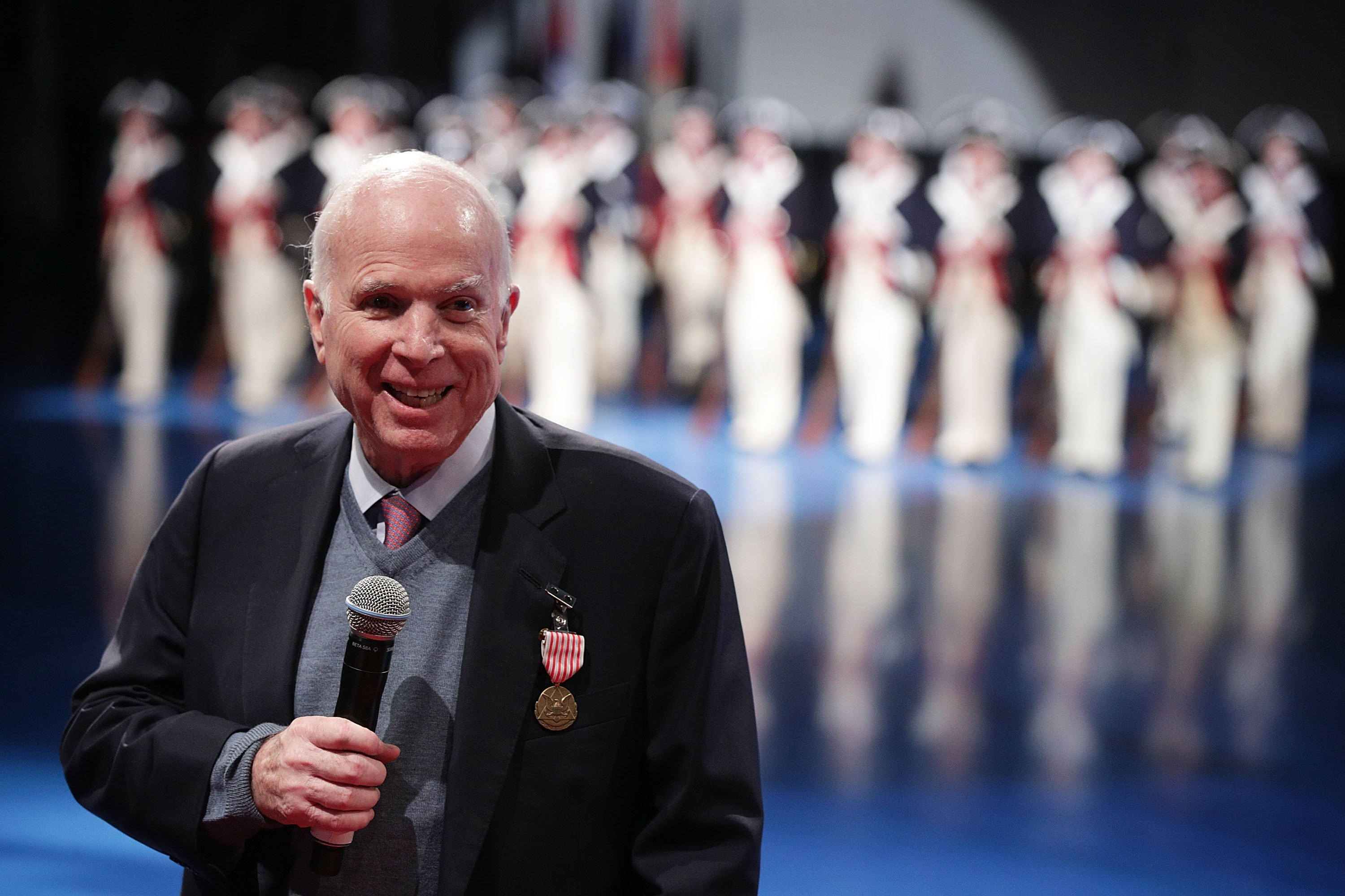 Late sen. John McCain after receiving a Civilian Service Medal. | Source: Getty Images