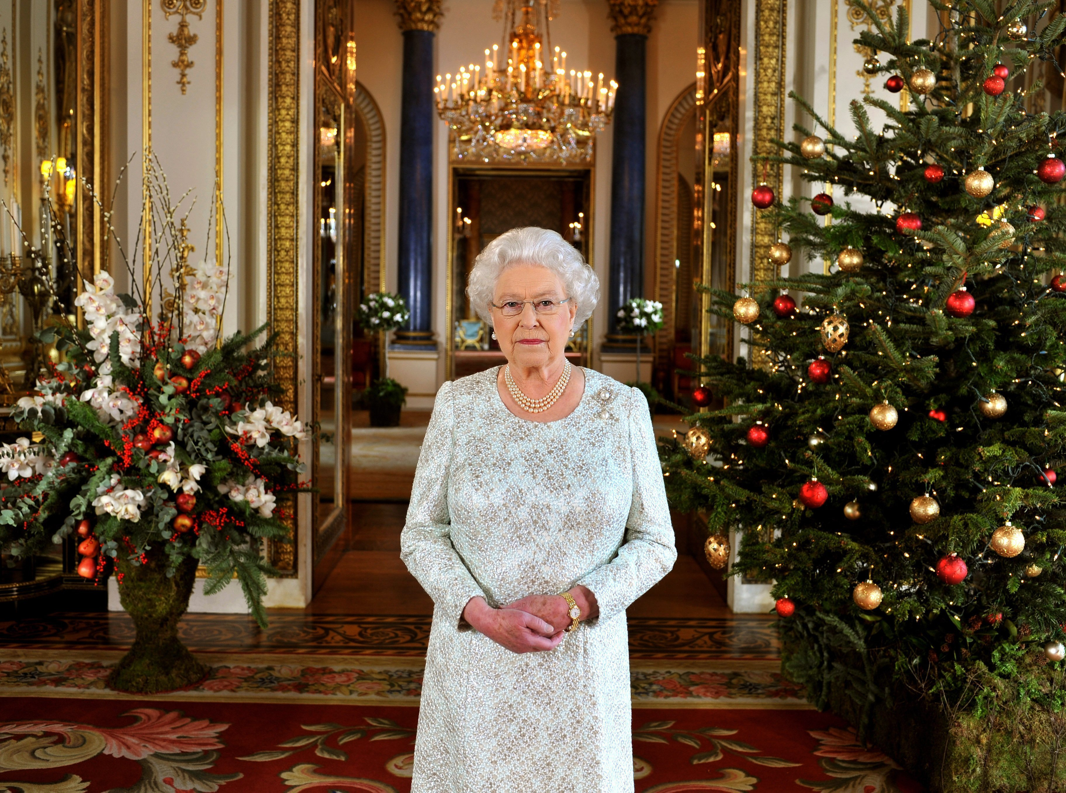 Queen Elizabeth II records her Christmas message to the Commonwealth, in 3D for the first time, in the White Drawing Room at Buckingham Palace on December 7, 2012, in London England. | Source: Getty Images.