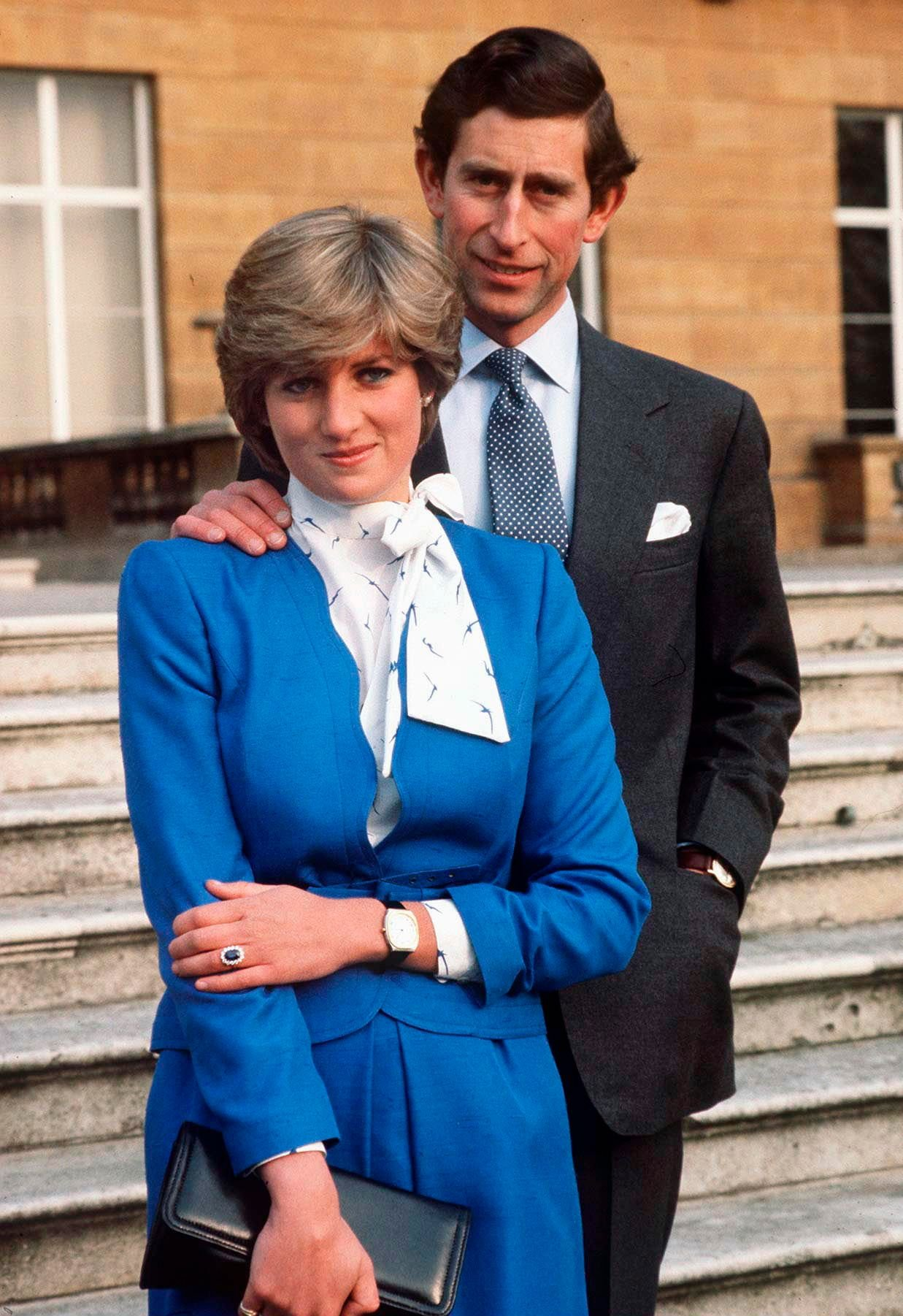 Lady Diana Spencer shows off her sapphire and diamond engagement ring while posing with Prince Charles at Buckingham Palace after the announcement of their engagement | Photo: Tim Graham Photo Library/Getty Images