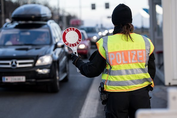A policewoman controlling traffic on a busy road | Photo: Getty Images