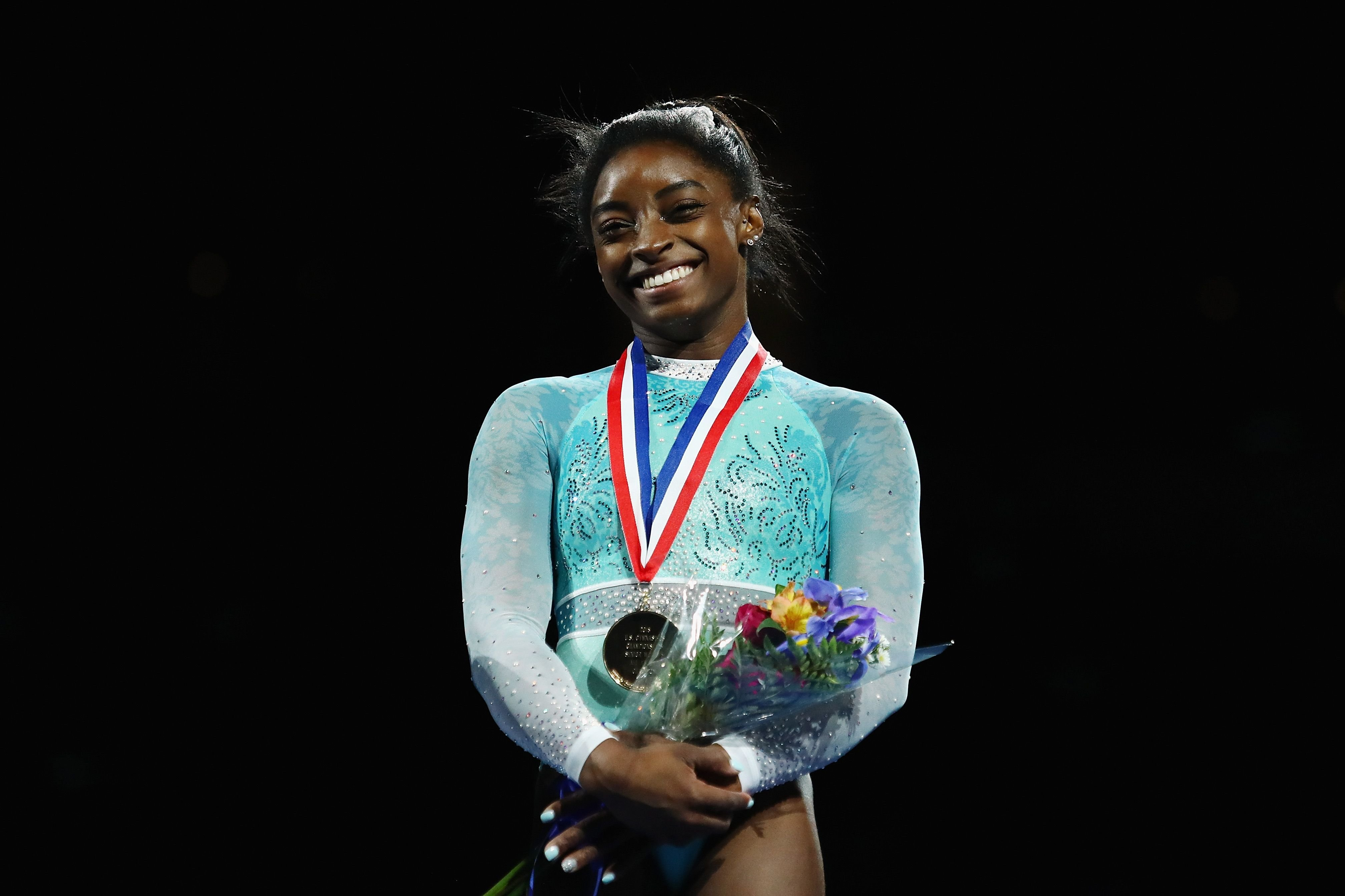 Simone Biles stands on the podium during day four of the U.S. Gymnastics Championships 2018 at TD Garden on August 19, 2018 in Boston, Massachusetts. | Photo: Getty Images.