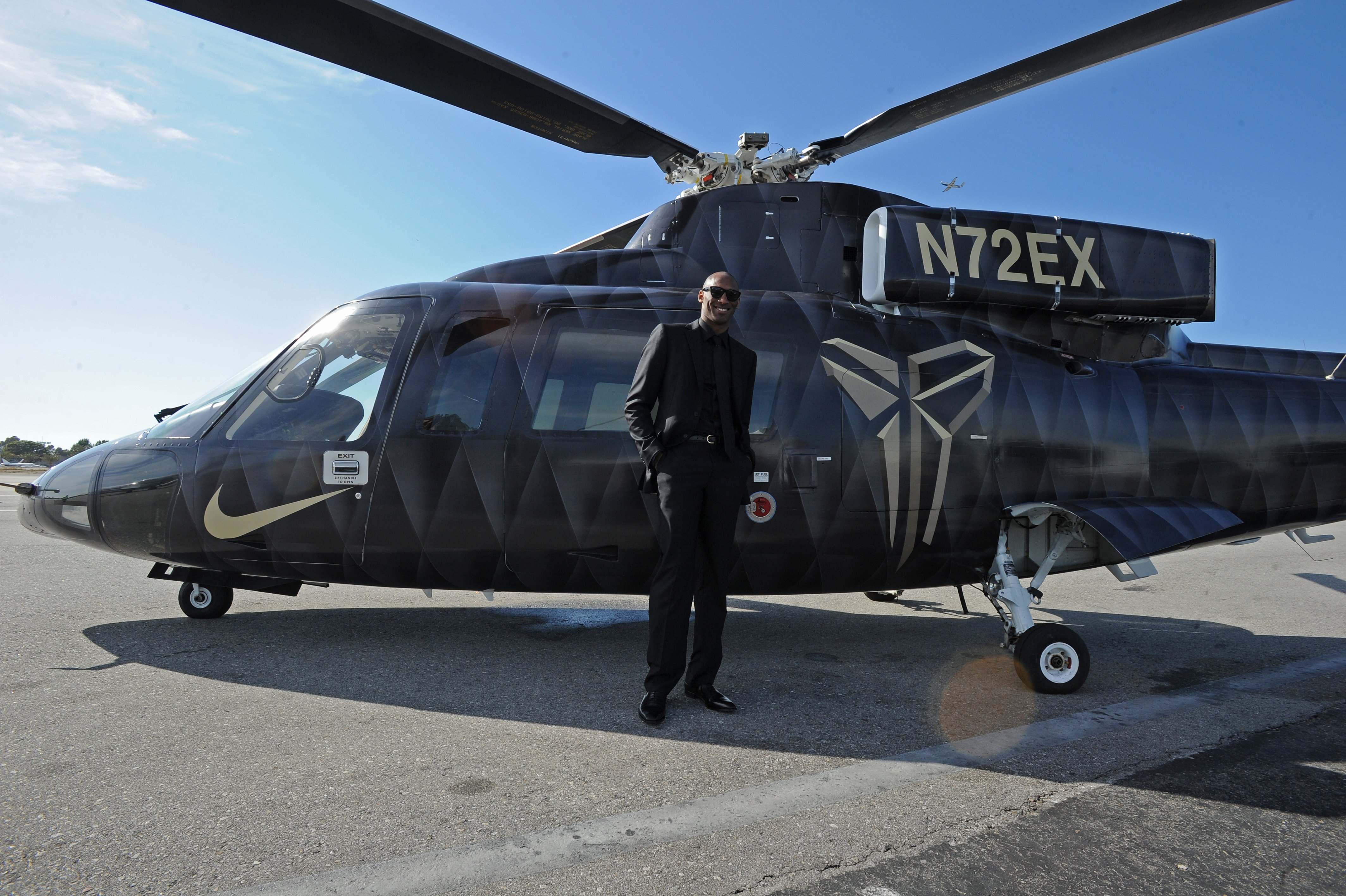 Kobe Bryant #24 of the Los Angeles Lakers poses for a photo in front of the helicopter he took to his last game against the Utah Jazz on April 13, 2016, at Staples Center in Los Angeles, California. | Source: Getty Images.