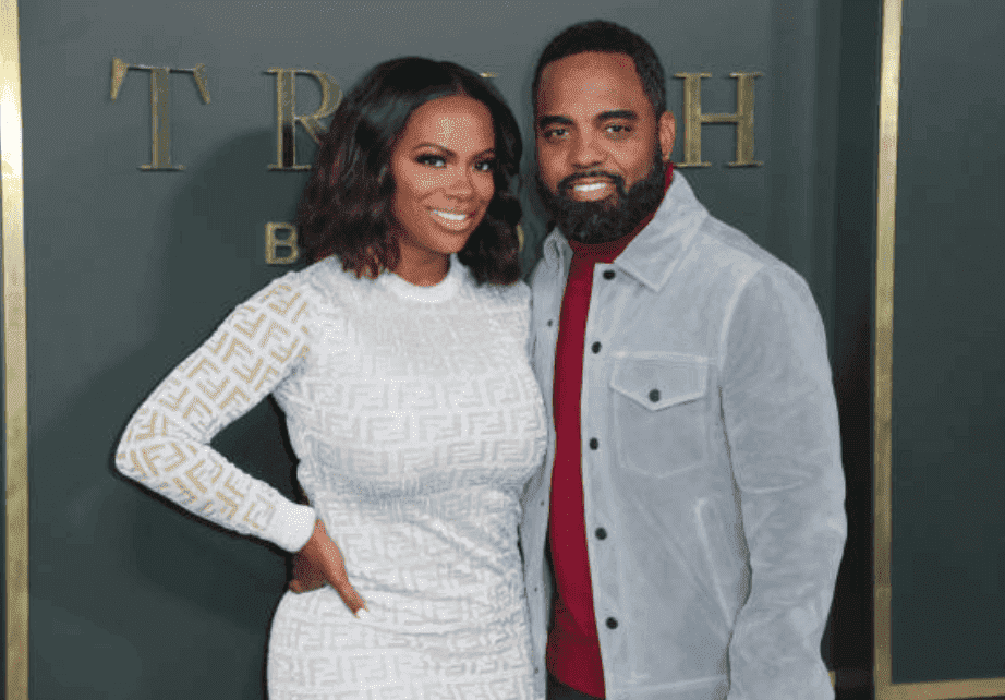 "Kandi Burruss and her husband, Todd Tucker pose on the red carpet at the Premiere for ""Truth Be Told,"" at AMPAS Samuel Goldwyn Theater, on November 11, 2019, California 