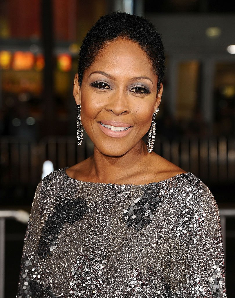"""Monica Calhoun arrives on the red carpet at the premiere for """"The Best Man Holiday"""" on November 5, 2013, in Hollywood, California 