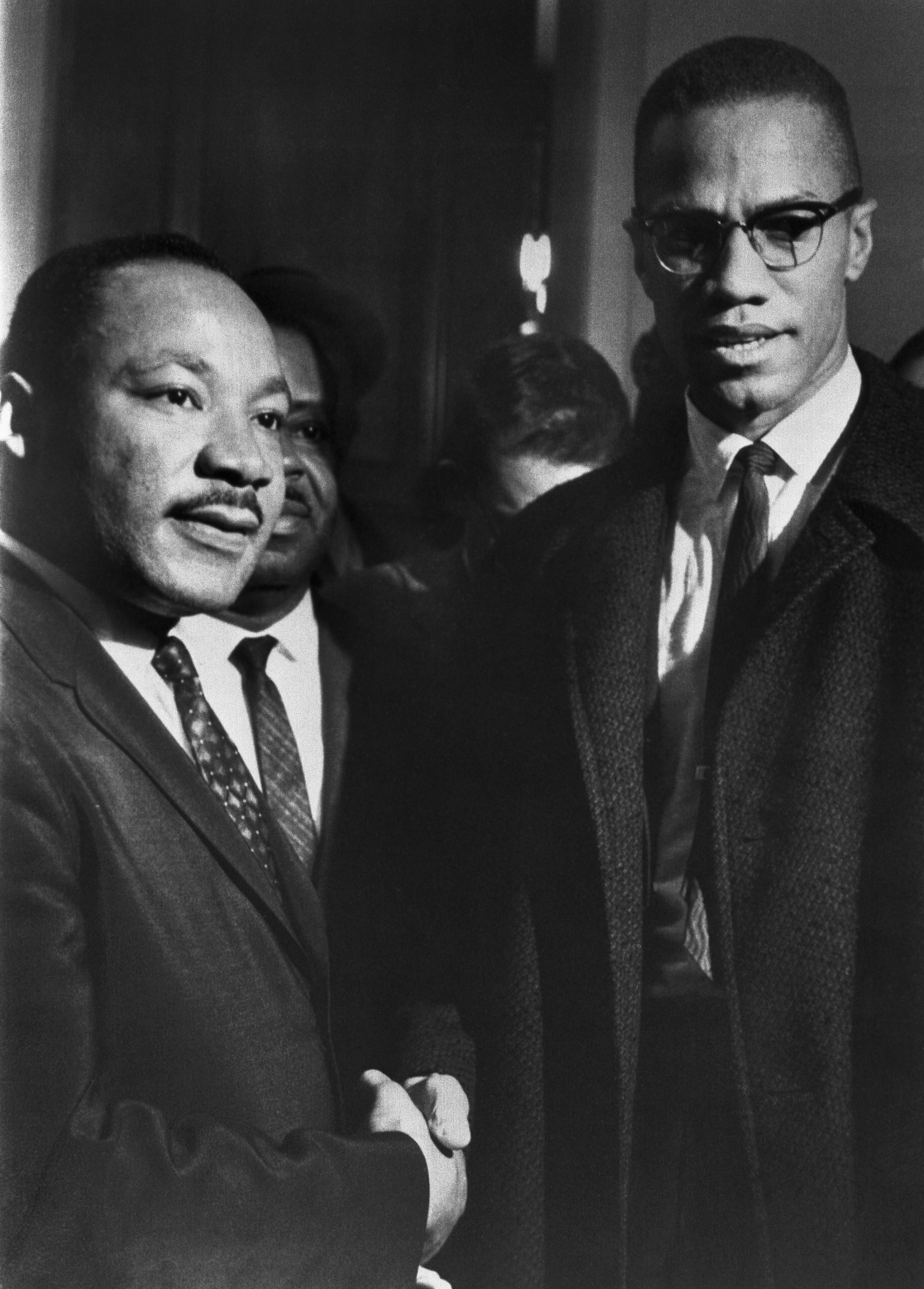The brief, and only, meeting between Malcolm X (1925-1965) and Martin Luther King (1929-1968), in the halls of the US Capitol, attending a Senate hearing on the Civil Rights Act, Washington DC, 26th March 1964. | Source: Getty Images