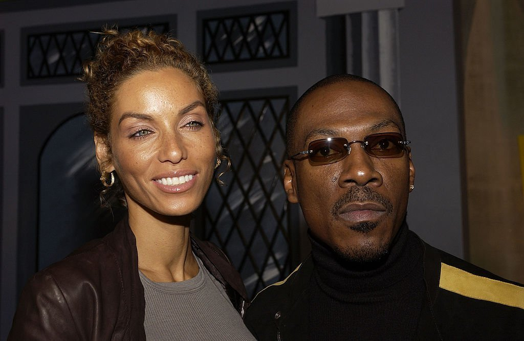 Actor Eddie Murphy and his wife Nicole arrive at the Shrek 2 DVD release party | Photo: Getty Images
