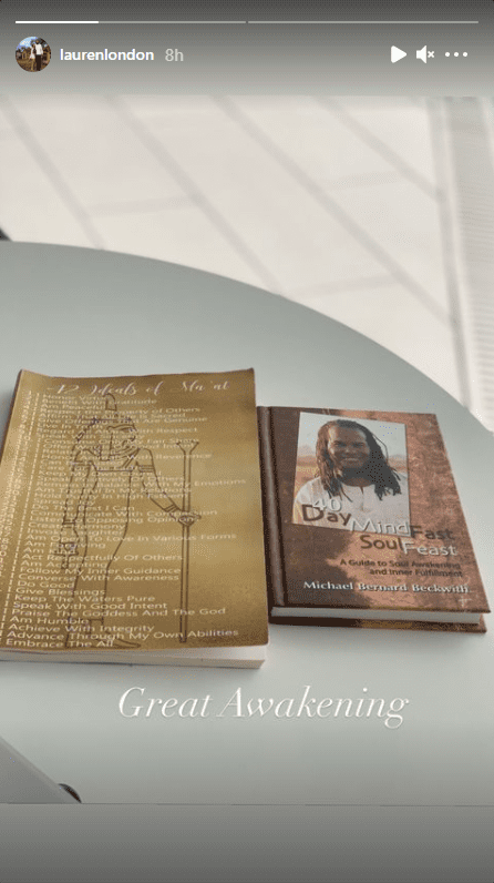 "Screenshot of photo of two books: ""42 Ideals of Ma'at"" and ""40 Day Mind Fast Soul Feast."" 