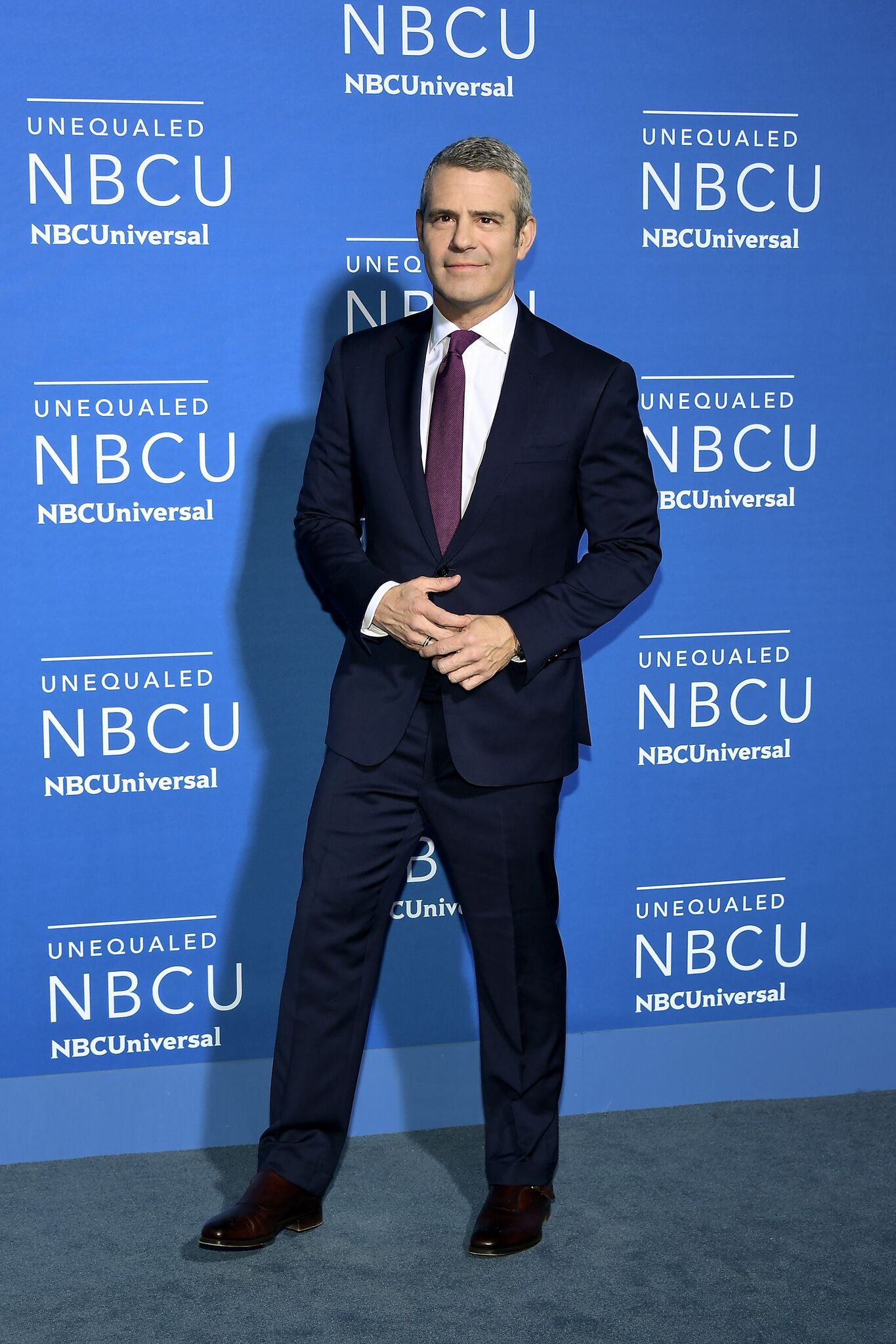 Andy Cohen posing for picture at NBCU event | Getty Images