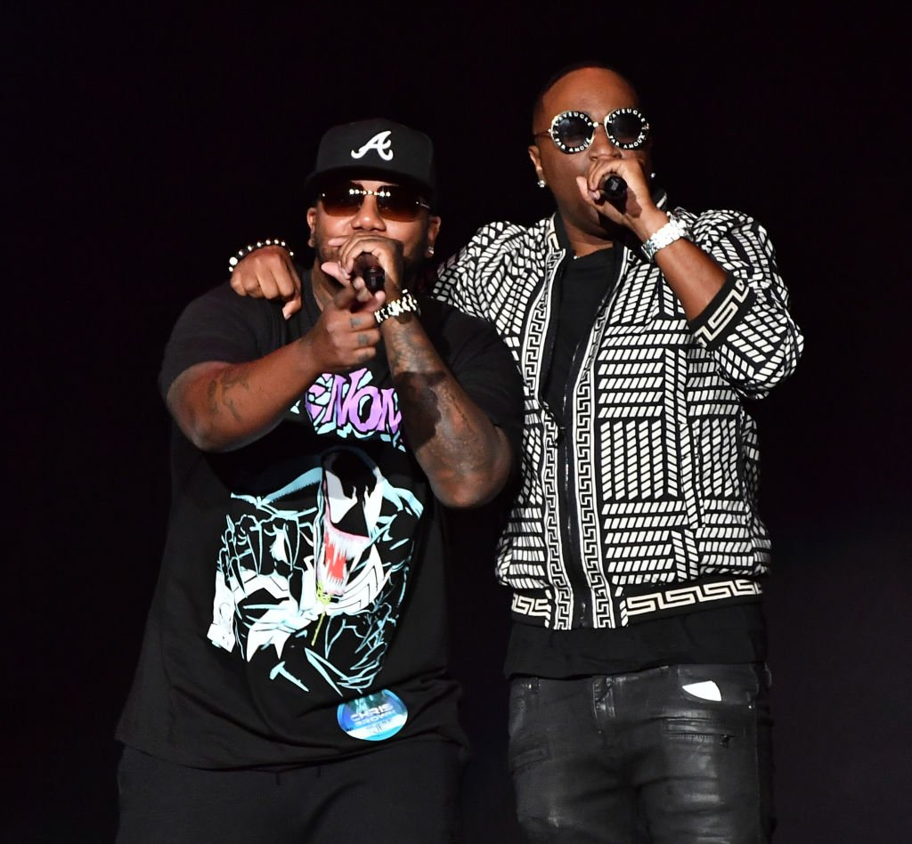 """Michael """"Mike"""" Keith and Marvin """"Slim"""" Scandrick of 112 performing onstage during the """"IndiGOAT"""" tour at State Farm Arena on October 02, 2019 in Atlanta, Georgia   Photo: Getty Images"""