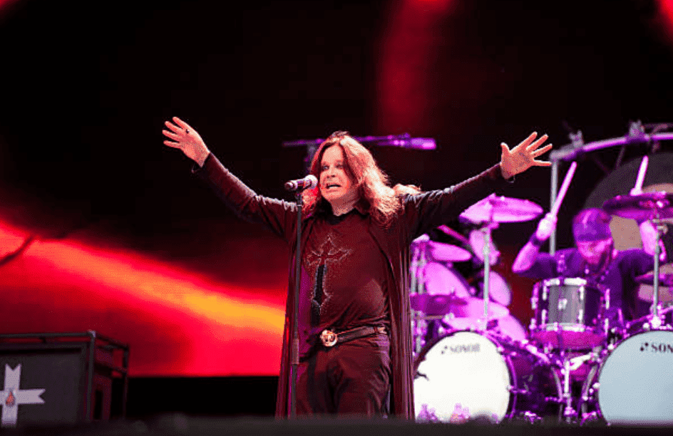 Ozzy Osbourne stand in front of a mic as he performs live onstage at the Download Festival, June 10, 2012, in Donington Park | Source: Getty Images