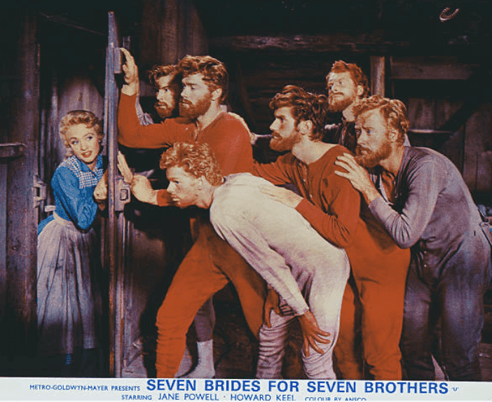 """Jane Powell poses with several actors during a movie scene on the poster for """"Seven Brides For Seven Brothers,"""" 1954 