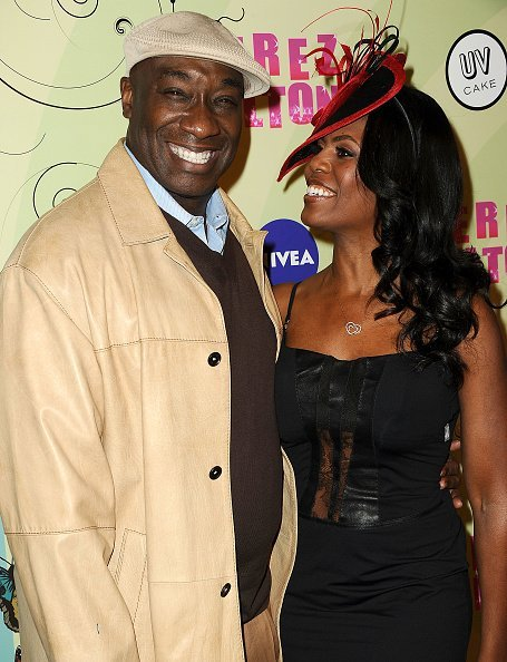 Actor Michael Clarke Duncan and Omarosa Manigault-Stallworth attend Perez Hilton's Mad Hatter tea party birthday celebration on March 24, 2012 in Los Angeles, California | Photo: Getty Images